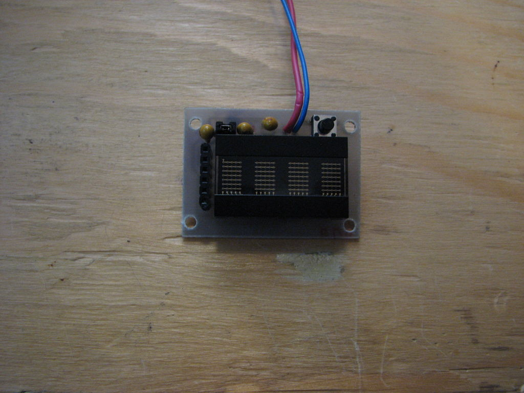Programmable watch with four character