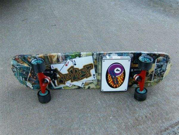 Skateboard with PIC microcontroller and LEDs