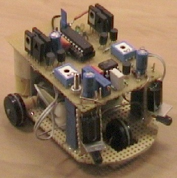 Small 3-wheel ROBOT with PIC16F84 brain & InfraRed eyes.