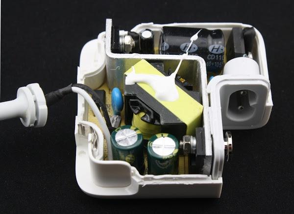 Counterfeit Macbook charger teardown convincing outside but dangerous inside