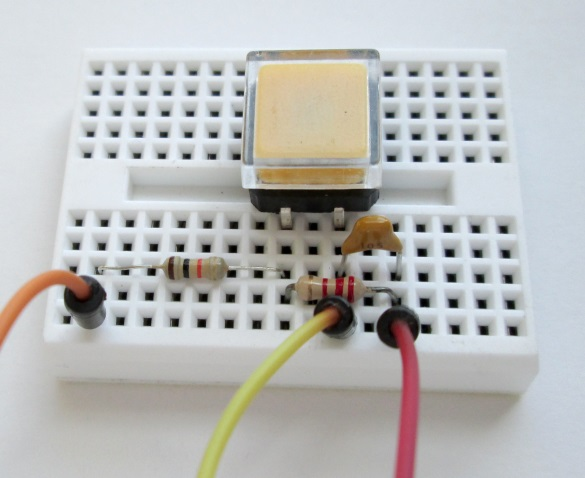 Start Stop switch with debouncing circuit is arranged on a breadboard