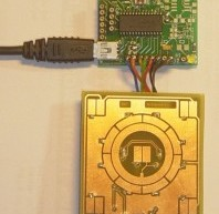 TD-USB-02 interface with touchpad sensor board and WinAmp interface using PIC18F2550