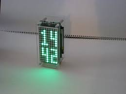 Using the MAX6955 LED Display Driver with a PIC Microcontroller to Scroll Messages