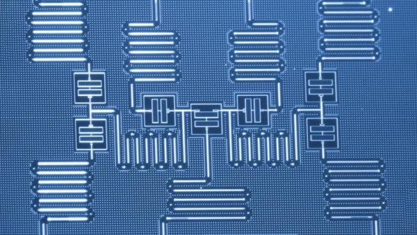 THREE QUANTUM COMPUTER COMPONENTS INTEGRATED ON ONE CHIP