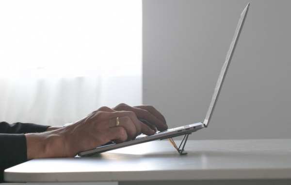 TESMO KICKSTAND TRULY INVISIBLE LAPTOP STAND THAT WEIGHS NOTHING AND TAKES UP ZERO SPACE